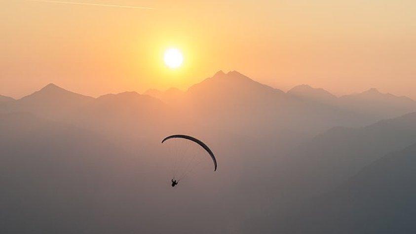 Paragliding at sunrise