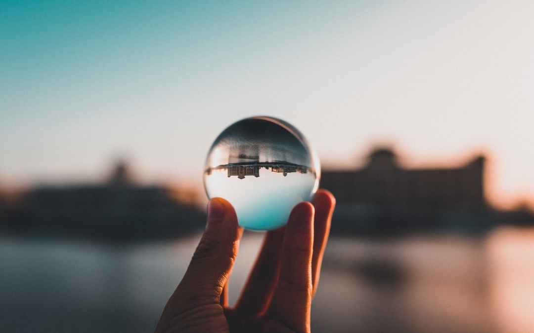 person holding lens ball