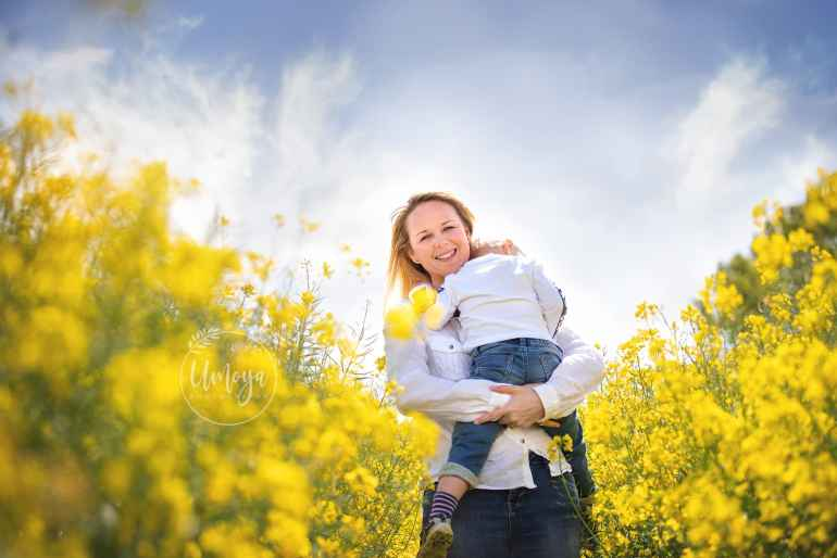 Mom and son in yellow fields, Sussex