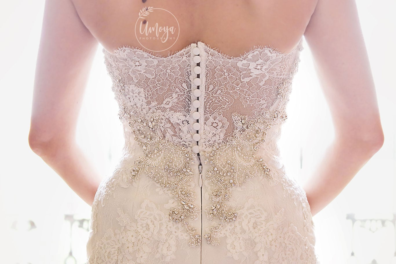 stunning back of dress detail by Kelly Rabie, Sussex wedding photographer