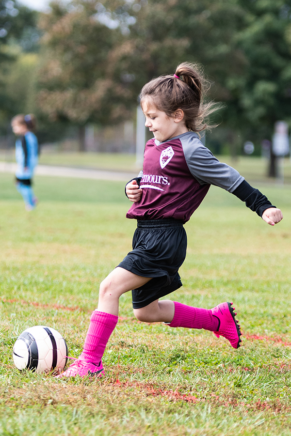 UMSC Girl Shooting a soccer ball