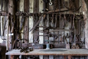 A photo of blacksmith tools hanging on a shop wall by by WaleedPS on DeviantArt