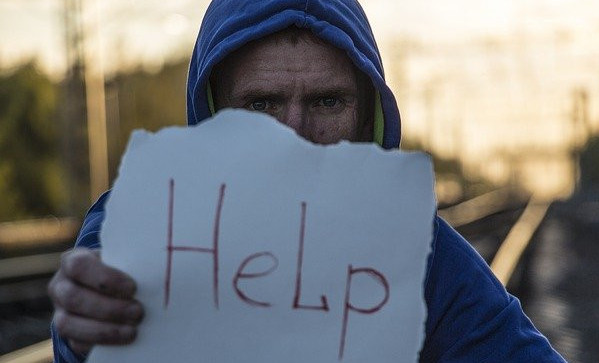 How to Boost GABA Levels - man holding help sign
