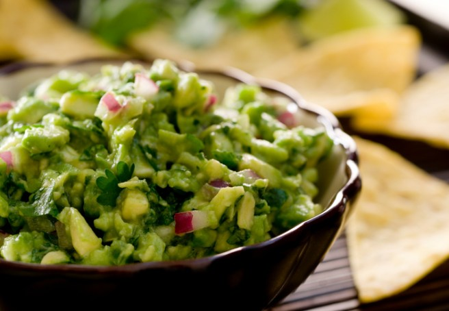 Closeup of a bowl of fresh guacamole. Selective focus; shallow depth of field.Related Images: