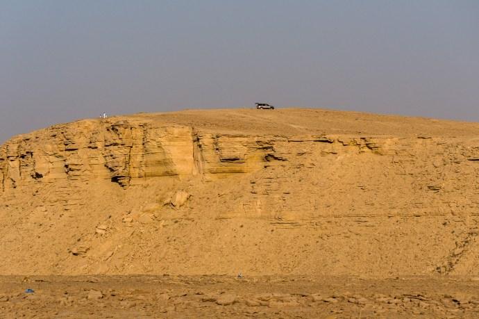Desert hill w car n people