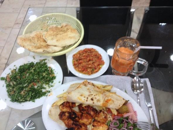 Tabouleh, babaganoush, rosemary pita bread, grileed chicken kebob.