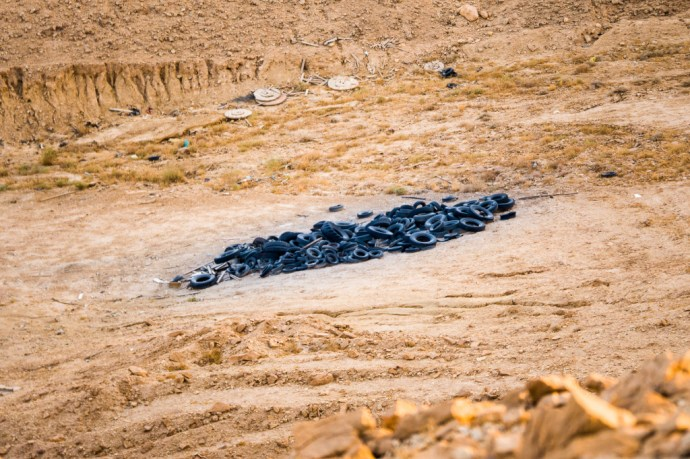 Tires in the desert swept by the river (when it rains).