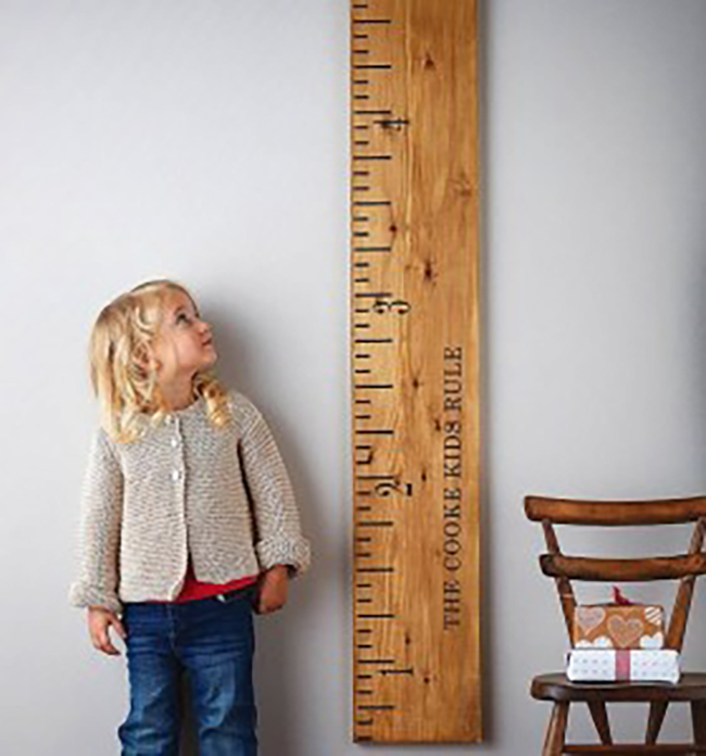 image of child next to meter stick measuring height