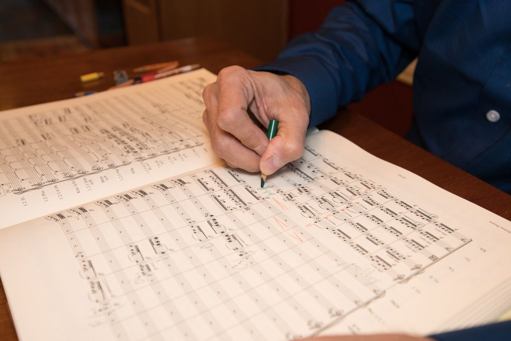 Austin Symphony Orchestra Conductor Peter Bay working on a score