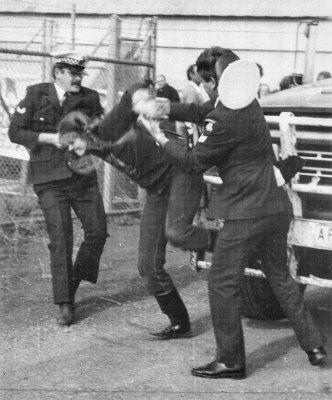 Patty Mark being arrested for her activism c.1980. This image was published in Animal Liberation Victoria's magazine in 1993 (photo supplied by Animal Liberation Victoria)