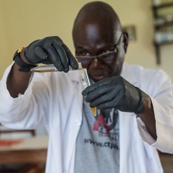 Stephen Rubanga, processing gorilla fecal samples.