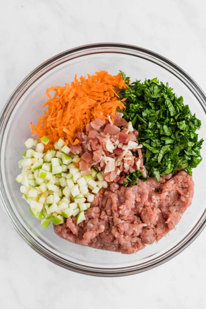 Chicken breast sausage ingredients in a bowl