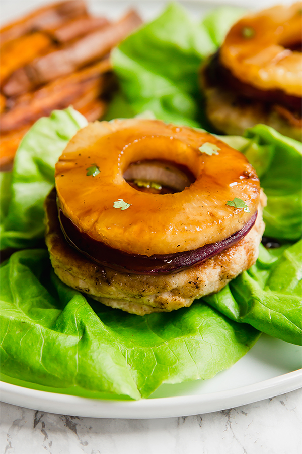 These Hawaiian Teriyaki Chicken Burgers are next level decadent. With grilled pineapple and a yummy teriyaki sauce, they're perfect for a summer day. These burgers are healthier, paleo, whole30, and AIP.