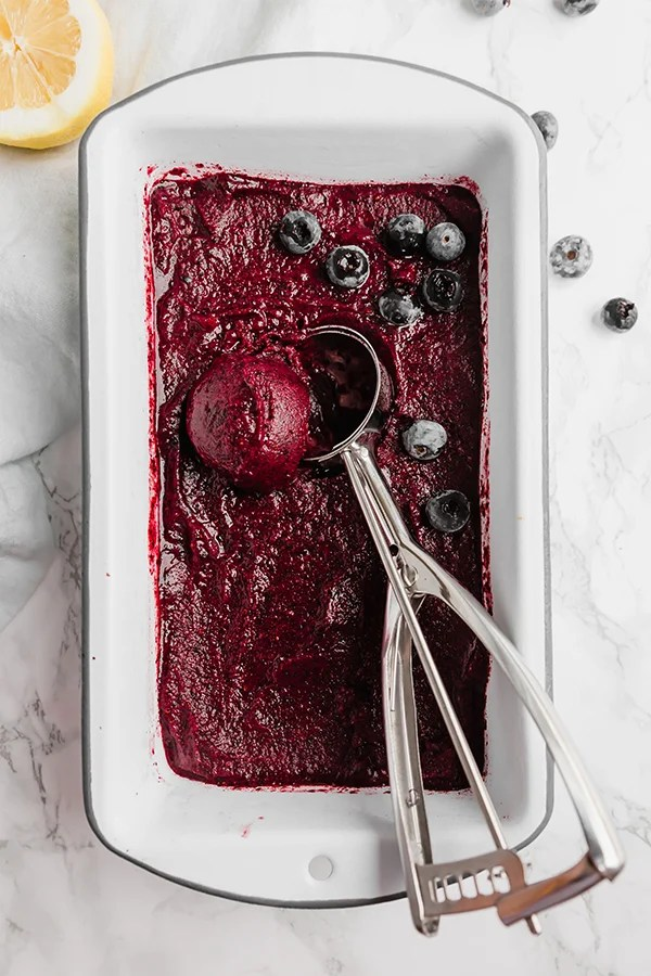 Lemon blueberry sorbet in loaf pan with scoop