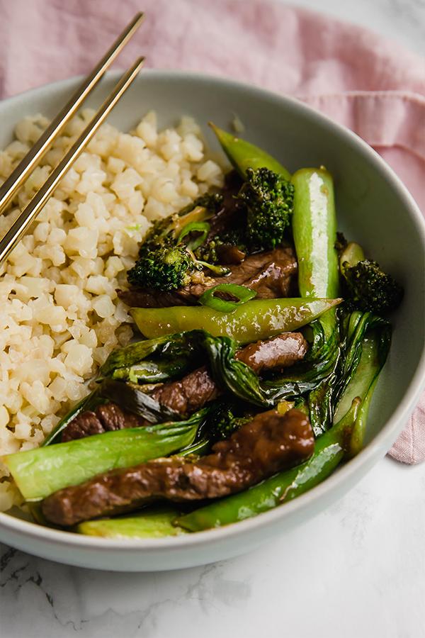 Beef stir fry in bowl with cauliflower rice