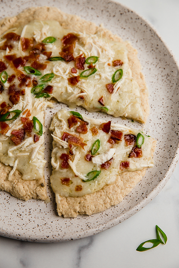 bacon ranch pizza slice on a plate