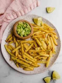 jicama fries on plate with guacamole