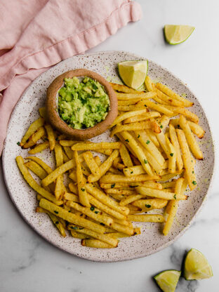 jicama fries on plate with guacamole