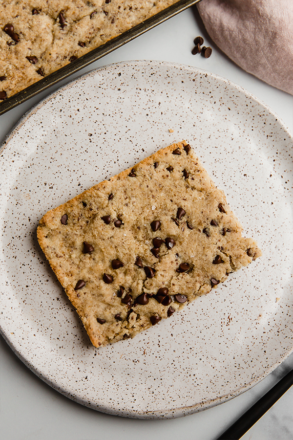 slice of sheet pan chocolate chip cookie on plate