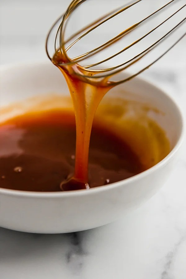 sweet and sour sauce with whisk