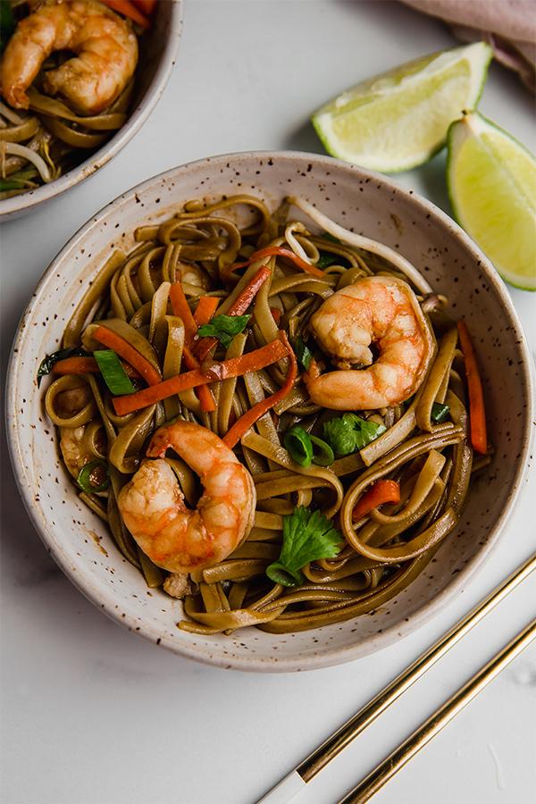 gluten free pad thai in bowl with chopsticks