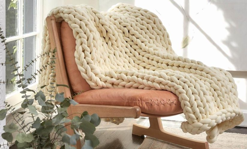 cream weighted blanket on living room chair