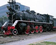 Liu-Bolin-Hiding-in-the-City_73-Decorated-with-the-Locomotive-2008