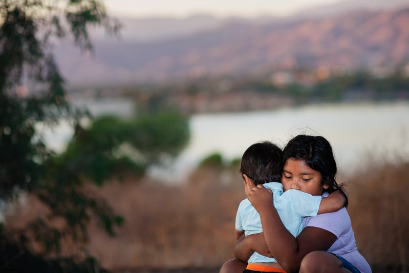 Brother and sister separated from parents as they cross the border