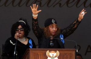 Daughters of Winnie Madikizela-Mandela, Zindzi Mandela and Zenani Dlamini Mandela, speak at their mother's funeral in Orlando stadium in Soweto, South Africa, April 14, 2018. REUTERS/Mike Hutchings