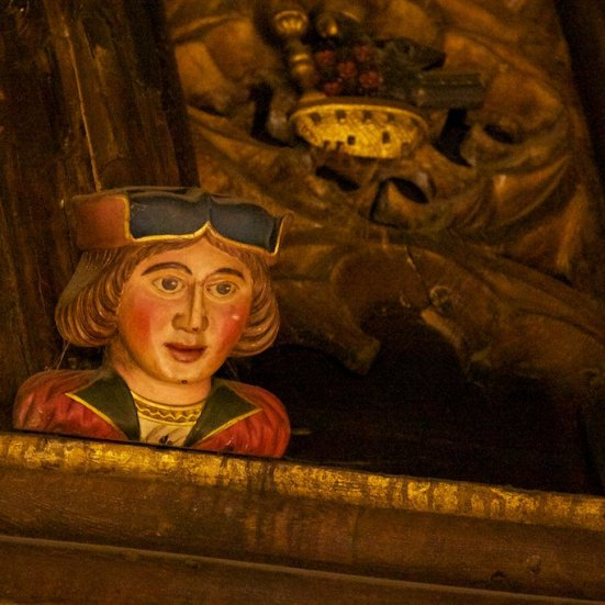 One of the eavesdroppers ornamenting the ceiling beams in the Great Hall.