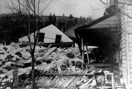 Villagers at Safe Harbor stand on a destroyed home's rooftop after the ice flooding of March 1904.