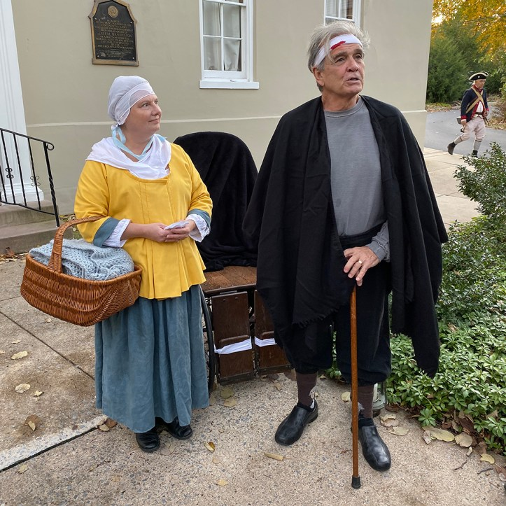 Revolutionary War soldier Ennis Tilghman and his nurse outside the Brothers' House in Lititz.