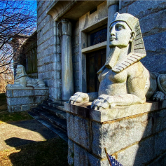 Egyptian sphinxes guarding the mausoleum's entrance.