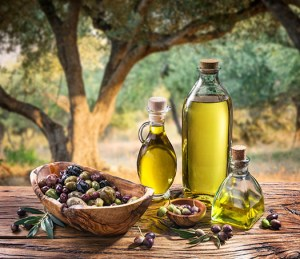 Olives and olive oil in the evening olive grove.