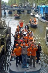 Orange-clad Dutchies take to the water on Queensday, the annual celebration of the queen's birthday.
