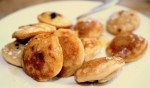 Don't miss Dutch poffertjes,  fluffy pancakes served with melted butter + powdered sugar.