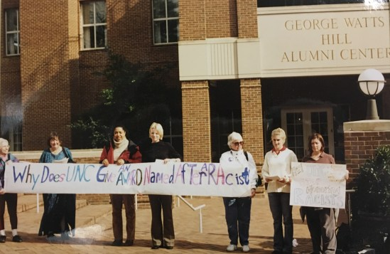 """""""Why Does UNC Give An Award Named After A Racist?"""" Sign at Protest of the Cornelia Phillips Spencer Bell Award, 2002 in the John Kenyon Chapman Papers #5441, Southern Historical Collection, Wilson Library, The University of North Carolina at Chapel Hill."""