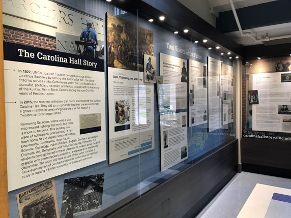 "Carolina Hall Exhibit, Curated by members of the Chancellor's Task Force on UNC-Chapel Hill History. Photograph in Brooks, Maya, ""Artifact of the Month: Saunders Hall plaque,"" North Carolina Miscellany Blog, 24 February 2017."