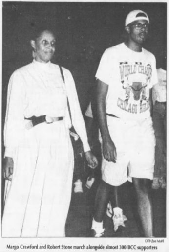 Margo Crawford and Robert Stone (Sonja Stone's son) marching on Chancellor Hardin's home. Photo by Joe Muhl inThe Daily Tar Heel, 4 September 1992, Page 1.