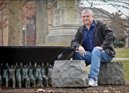 """Tim McMillan, creator of the Black & Blue Tour, at the Unsung Founders Memorial on McCorkle Place. """"'Black and Blue' tour traces Carolina's racial history,""""University Gazette,11 February 2014."""