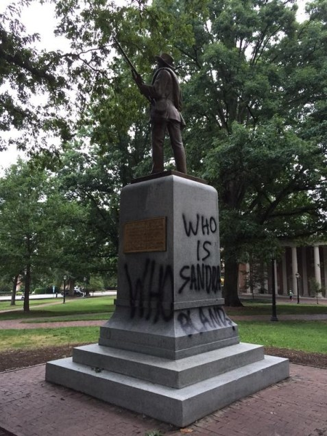 """""""Who Is Sandra Bland?,"""" Tagging of the Confederate Monument, Photo by Katie Williams in The Daily Tar Heel, 18 August 2015."""