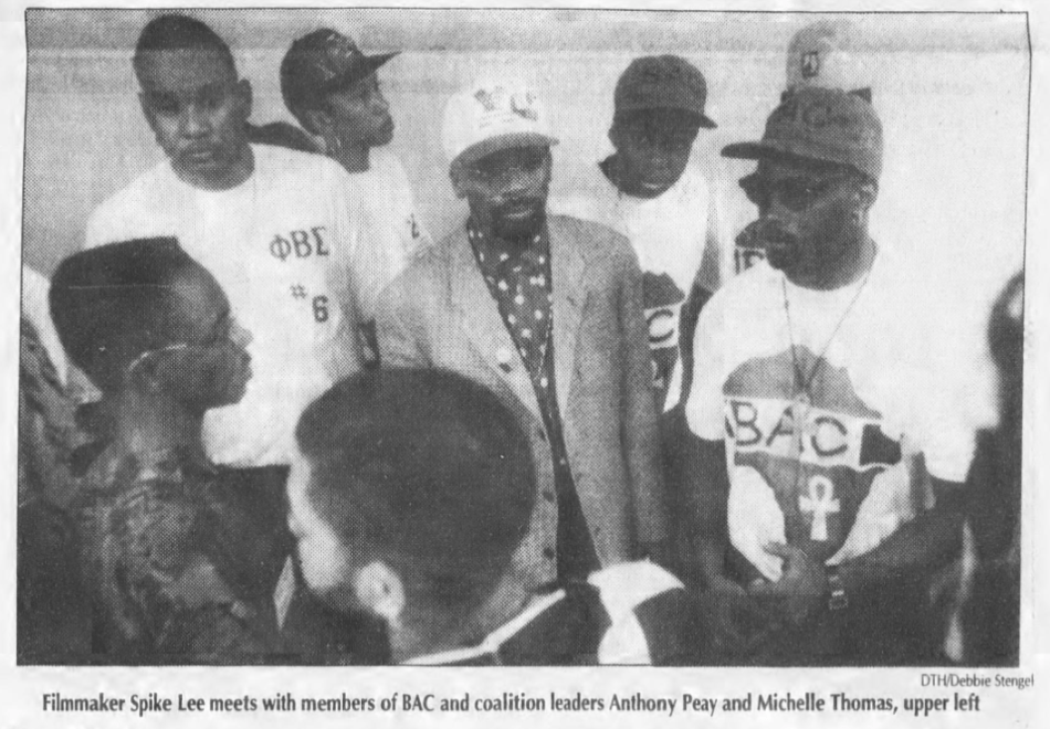 """Spike Lee and members of the BCC coalition. Photo by Debbie Stengel in Griffin, Anna, """"Spike Lee Urges Black Athletes to Utilize Their Financial Power,""""The Daily Tar Heel, 21 September 1992, Page 1."""