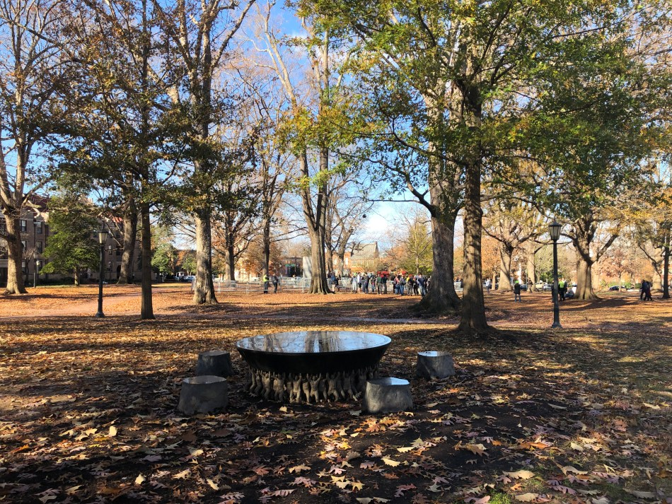 McCorkle Place, view of the former site of the Confederate Monument, Pro-Confederate rally and anti-fascist counter-rally, and the Unsung Founders Memorial. Personal Photograph. Charlotte Fryar. 16 December 2018.