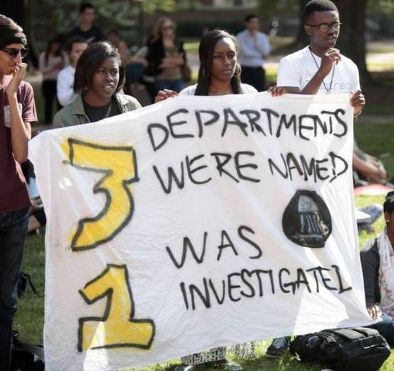 "Freshmen, from left, Tesarah Boyd, Jasmin Brooks and Adeyemi Olatunde hold a banner at the Wainstein Rally. Photo in Alexander, Johnathan, ""UNC students rally in support of African studies department,"" the Raleigh News and Observer, 29 October 2014."