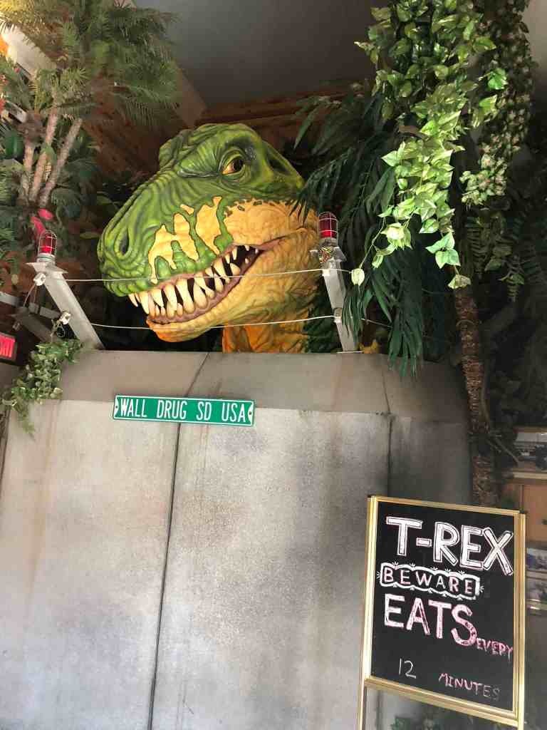 """About 5 seconds after we walked up to him, this guy started spewing steam, moving, blinking, and roaring. The kids were terrified and we spent the next two days talking about how the """"robot T-Rex"""" was not real."""