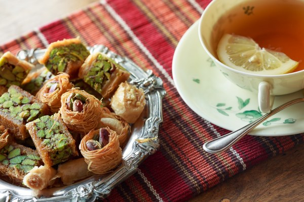 Turkish pistachio baklava and tea with lemon