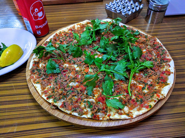 Turkish lahmacun with fresh herbs