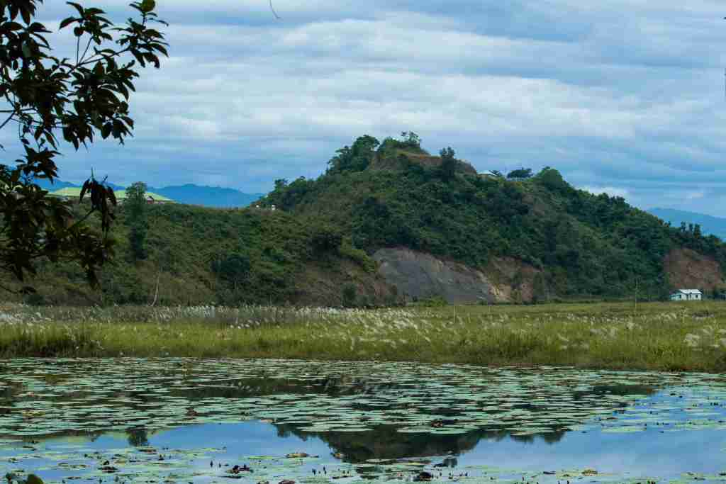 Glassy water of Loktak Lake and fringe villages along the hill