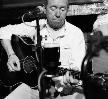 Flint, 'More and Byrne Acoustic band - singer on a stool shot 2