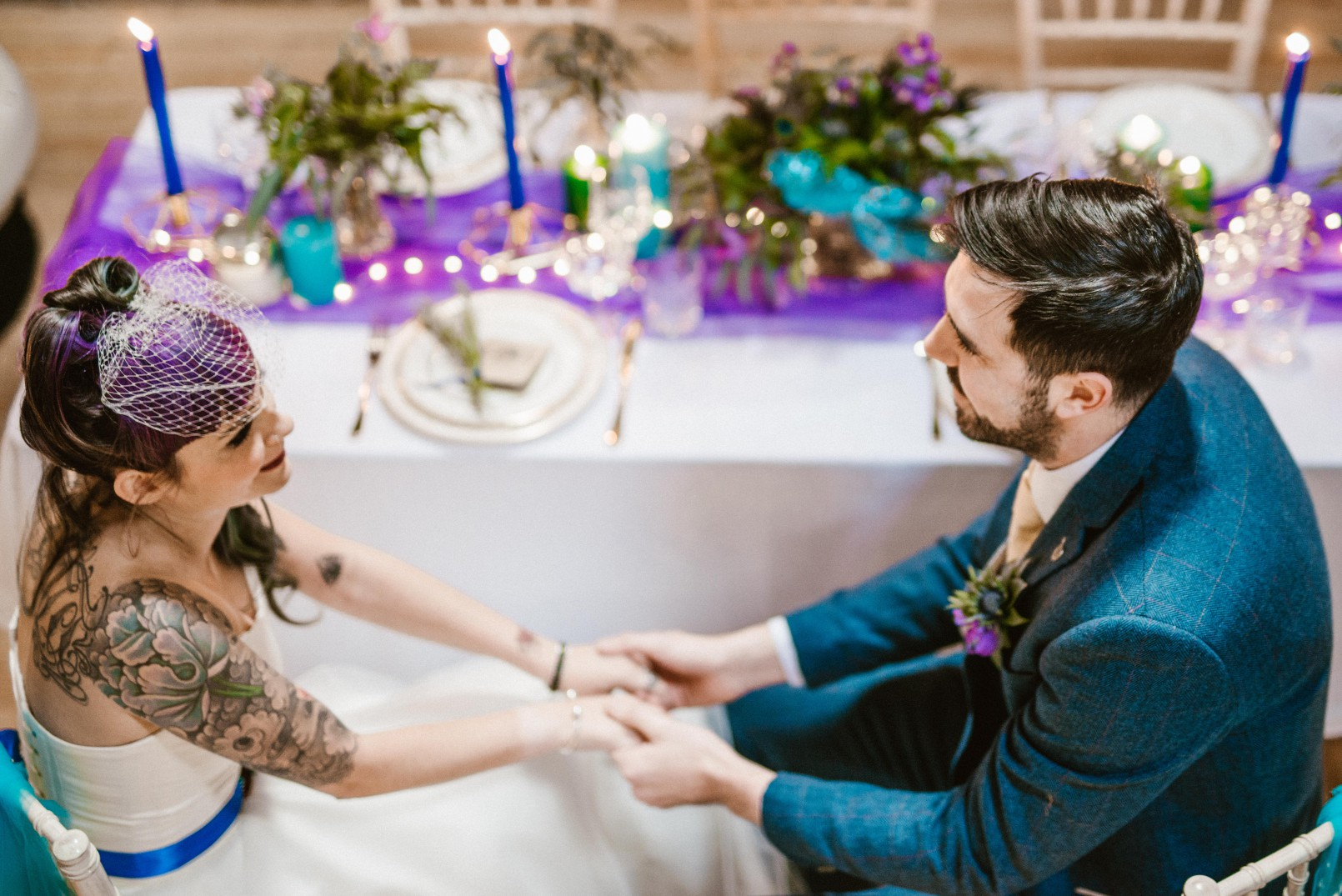 Peacock barns - alternative unconventional wedding photoshoot - rustic decadent - couple holding hands